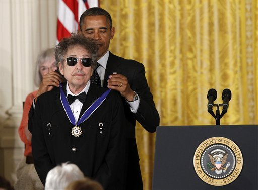 President Barack Obama presents rock legend Bob Dylan with a Medal of Freedom, Tuesday, May 29, 2012, during a ceremony at the White House in Washington. (AP Photo/Charles Dharapak)