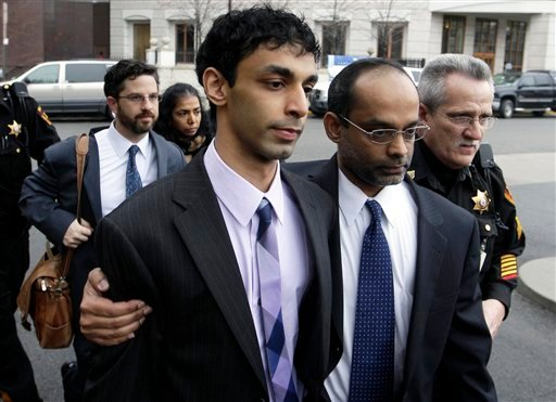 In this March 16, 2012 file photo, Dharun Ravi, center, and his father, Ravi Pazhani, leave court in New Brunswick, N.J. (AP Photo/Mel Evans, File)