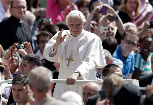 Pope Benedict XVI waves as he arrives for his weekly audience in St. Peter's square at the Vatican, Wednesday, May 30, 2012. (AP Photo/Riccardo De Luca)
