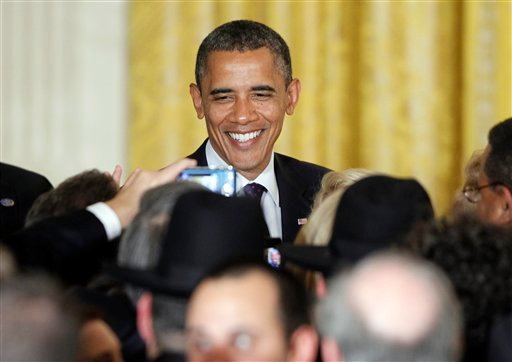 President Barack Obama greets audience members after he spoke at a Jewish American Heritage Month reception in the East Room at the White House in Washington, Wednesday, May 30, 2012. (AP Photo/Charles Dharapak)