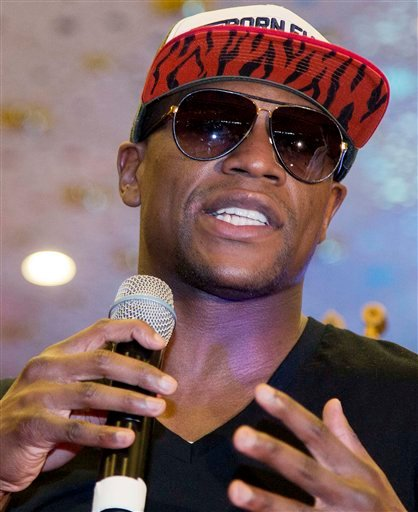 In this May 1, 2012, file photo, Floyd Mayweather Jr., talks to fans after arriving at the MGM Grand casino and hotel in Las Vegas.