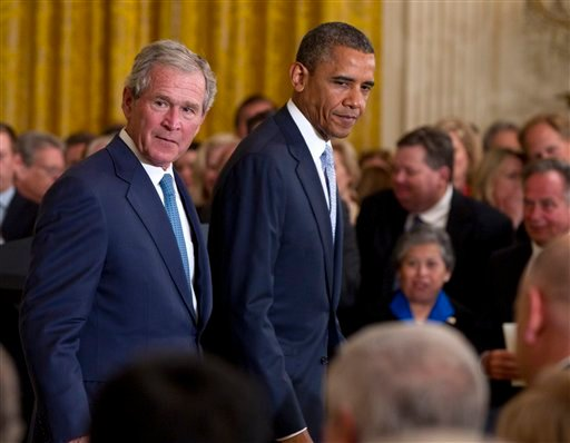President Barack Obama and former President George W. Bush walk from the stage in the East Room of the White House in Washington, Thursday, May 31, 2012, after unveiling of the Bush portrait. (AP Photo/Carolyn Kaster)