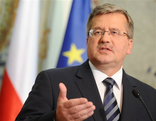 Polish President Bronislaw Komorowski gestures during a press conference as he informs about U.S. President's Barack Obama letter, in Warsaw, Poland, Friday, June 1, 2012. (AP Photo/Alik Keplicz)