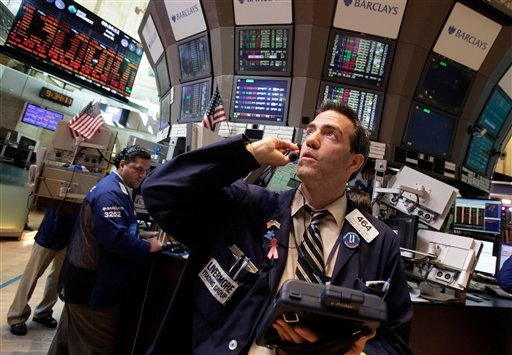 Trader Gregory Rowe works on the floor of the New York Stock Exchange Friday, June 1, 2012.