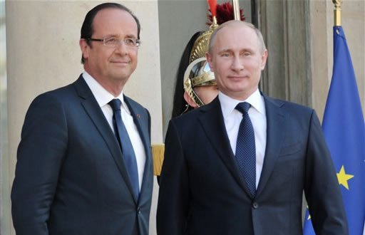 French President Francois Hollande, left, and Russian President Vladimir Putin meet at the Elysee Palace in Paris, France, Friday, June 1, 2012. (AP Photo/RIA-Novosti, Alexei Nikolsky, Government Press Service)