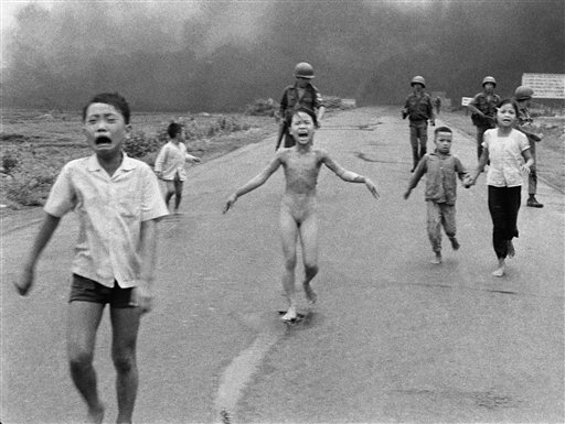 In this June 8, 1972 file photo, crying children, including 9-year-old Kim Phuc, center, run down Route 1 near Trang Bang, Vietnam after an aerial napalm attack on suspected Viet Cong hiding places as South Vietnamese forces from the 25th Division walk b
