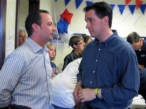 Wisconsin Gov. Scott Walker, right, talks with Republican National Committee Chairman Reince Priebus at a Republican campaign office in Germantown, Wis., on Sunday, June 3, 2012. (AP)