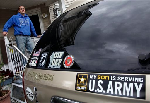 Senior John Sabatino, 17, stands near the family van outside his home in Somerdale, N.J., Monday, June 4, 2012. Sabatino will graduate June 13, before heading off to U.S. Army training June 26. (AP Photo/Mel Evans)