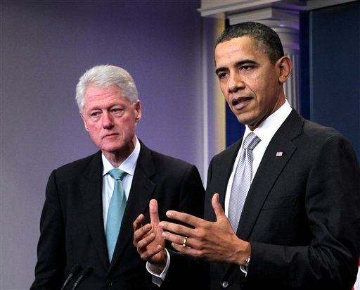 FILE - In this Dec. 10, 2010 file photo, President Barack Obama, accompanied by former President Bill Clinton in the briefing room of the White House in Washington. (AP Photo/J. Scott Applewhite, File)