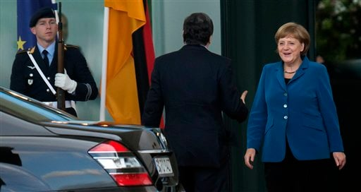 German Chancellor Angela Merkel, right, welcomes President of the European Union Commission Jose Manuel Barroso for talks at the chancellery in Berlin, Germany, Monday, June 4, 2012. (AP Photo/dapd, Clemens Bilan)
