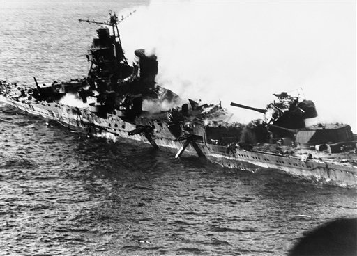 In this June 1942 file photo, a Mogami class Japanese cruiser is the flaming target of carrier-based U.S. naval aircraft in the historic battle of Midway which raged for three days in June 1942.