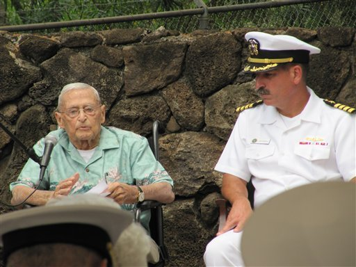 In this photo taken June 1, 2012, retired Rear Adm. Mac Showers, left, the last surviving member of the intelligence team that deciphered Japanese messages in the lead up to the Battle of Midway, speaks during a ceremony in Pearl Harbor, Hawaii.