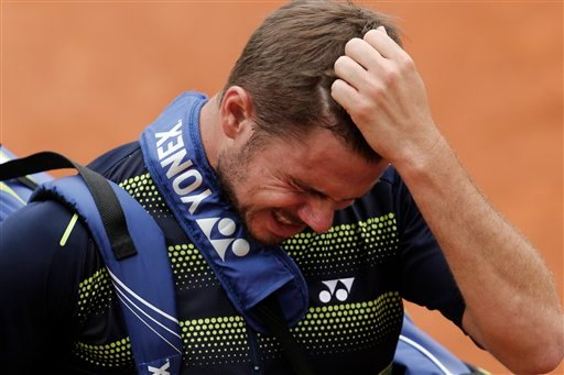 Stanislas Wawrinka of Switzerland leaves the court after losing his fourth round match against Jo-Wilfried Tsonga of France at the French Open tennis tournament in Roland Garros stadium in Paris, Monday June 4, 2012. (AP)