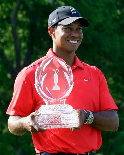 Tiger Woods holds up the trophy after winning the Memorial golf tournament at the Muirfield Village Golf Club in Dublin, Ohio, Sunday, June 3, 2012.