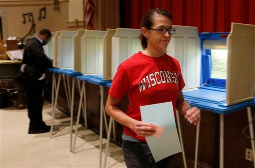 A woman casts her ballot Tuesday, June 5, 2012, in Milwaukee. Wisconsin Republican Gov. Scott Walker is taking on Democratic challenger Tom Barrett in a recall election. (AP Photo/Jeffrey Phelps)