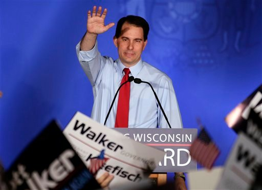 Wisconsin Republican Gov. Scott Walker waves at his victory party Tuesday, June 5, 2012, in Waukesha, Wis. Walker defeated Democratic challenger Tom Barrett in a special recall election. (AP Photo/Morry Gash)