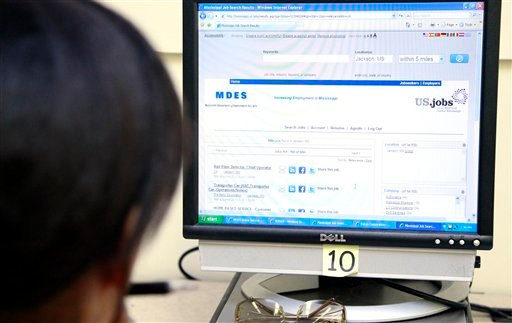 In this Friday, June 1, 2012, file photo, Tanya Scott searches job sites for employment possibilities at the Mississippi Department of Employment Security WIN Job Center in Jackson, Miss. (AP Photo/Rogelio V. Solis)