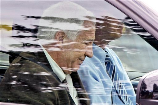 Former Penn State assistant football coach Jerry Sandusky leaves with attorney Joe Amendola after jury selection was completed for Sandusky's trial on child sexual abuse charges, at the Centre County Courthouse June 6, 2012. (AP Photo/Gene J. Puskar)