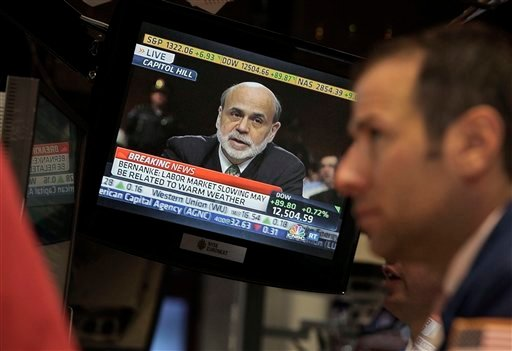 Federal Reserve Chairman Ben Bernanke appears on a television screen on the floor of the New York Stock Exchange Thursday, June 7, 2012. (AP Photo/Richard Drew)