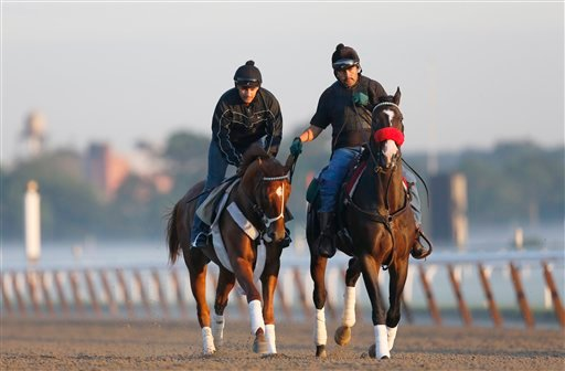 I'll Have Another, left, with exercise rider Jonny Garcia, accompanied by stablemate Lava Man, trains at Belmont Park, Friday, June 8, 2012 in Elmont, N.Y.