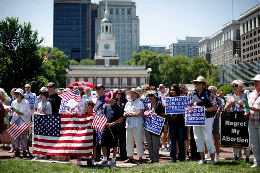 Demonstrators protest against the Obama administration mandate that employers provide workers birth control coverage, in view of Independence Hall, Friday, June 8, 2012, in Philadelphia. (AP Photo/Matt Rourke)