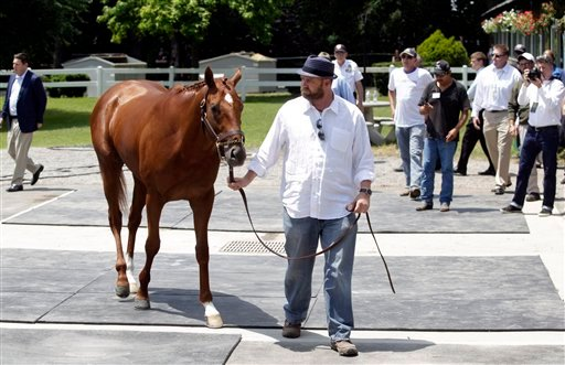 Trainer Doug O'Neill brings out I'll Have Another, the Kentucky Derby and Preakness winner, for a news conference at Belmont Park in Elmont, N.Y., on Friday, June 8, 2012. (AP Photo/Mike Groll)