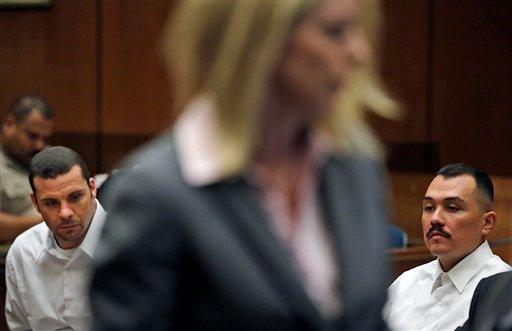 Los Angeles County Deputy District Attorney Michele Hanisee, center, presents evidence against defendants Louie Sanchez, right, and Marvin Norwood, left, during a preliminary hearing Wednesday, June 6 2012 in Los Angeles Superior Court. (AP Photo)