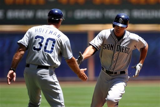 San Diego Padres' Glenn Hoffman congratulates Will Venable, right, after his solo home run against the Milwaukee Brewers during the first inning of a baseball game, Sunday, June 10, 2012, in Milwaukee. (AP Photo/Jim Prisching)