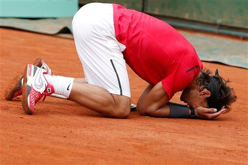 Rafael Nadal of Spain celebrates winning the mens final match against Novak Djokovic of Serbia at the French Open tennis tournament in Roland Garros stadium in Paris, Monday June 11, 2012. (AP Photo/Bernat Armangue)