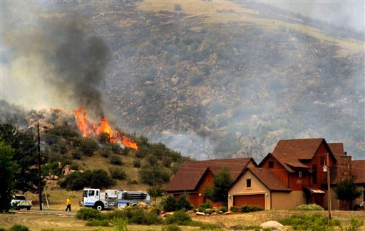 Poudre Fire Authority crews battle a wildfire in a mountainous area about 15 miles west of Fort Collins, Colo., on Sunday, June 10, 2012. (AP Photo/The Denver Post, Helen H. Richardson)