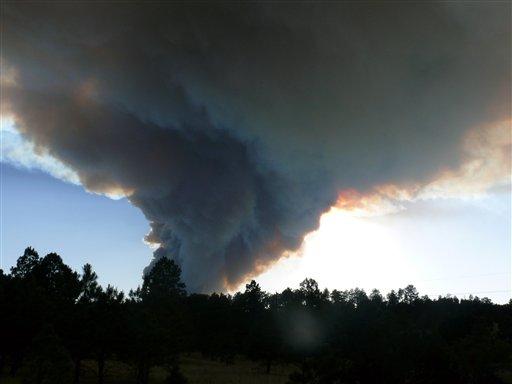Smoke billows from the Little Bear fire in southeastern New Mexico near Ruidoso, Saturday, June 9, 2012. (AP Photo/Ruidoso News, Jim Kalvelag)