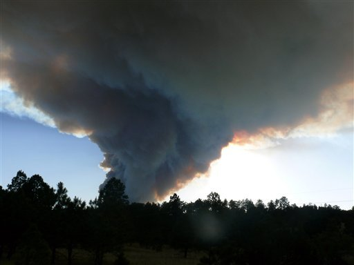 Smoke billows from the Little Bear fire in southeastern New Mexico near Ruidoso, Saturday, June 9, 2012. (AP Photo/Ruidoso News, Jim Kalvelag)