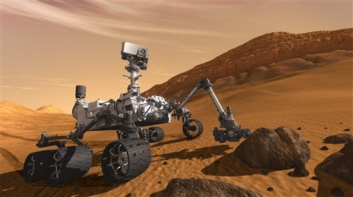 FILE - In this 2011 artist's rendering provided by NASA/JPL-Caltech, the Mars Science Laboratory Curiosity rover examines a rock on Mars with a set of tools at the end of its arm, which extends about 2 meters (7 feet). (AP Photo/NASA/JPL-Caltech,File)