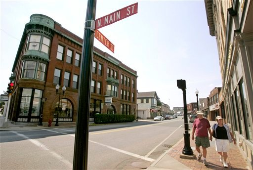 FILE - In this July 25, 2007, file photo, pedestrians stroll through downtown Middleborough, Mass. (AP Photo/Steven Senne, File)