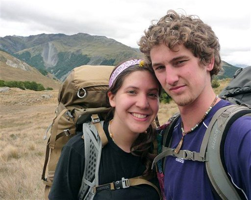 In this photo provided by Alec Brown, Alec, right, and his girlfriend Erica Klintworth pose near mountains at an unknown location. (AP Photo/Alec Brown)