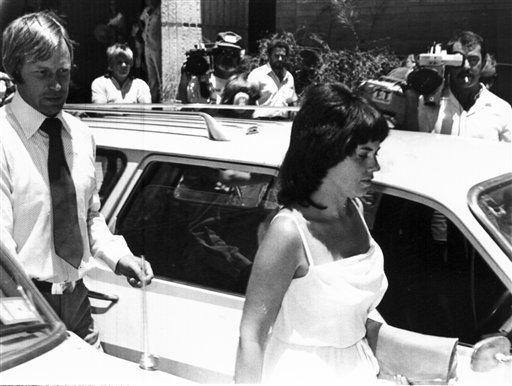 FILE - In this Feb. 2, 1982, file photo, Michael, left, and Lindy Chamberlain leave a courthouse in Alice Springs, Australia. (AP Photo/File)