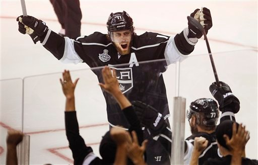 Los Angeles Kings center Anze Kopitar celebrates after a second period goal by Kings' Jeff Carter against the New Jersey Devils.
