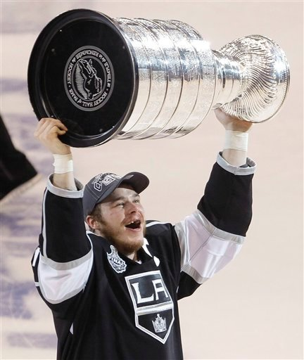 Los Angeles Kings captain Dustin Brown holds up the Stanley Cup after the Kings beat the New Jersey Devils 6-1 during Game 6 of the NHL hockey Stanley Cup finals, Monday, June 11, 2012, in Los Angeles.