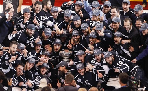 The Los Angeles Kings pose for a photo after beating the New Jersey Devils.