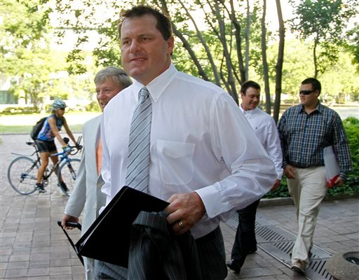 Former Major League Baseball pitcher Roger Clemens, accompanied by his attorney Rusty Hardin, left, arrives at federal court in Washington, Monday, June 11, 2012, for his perjury trial. (AP Photo/Haraz N. Ghanbari)