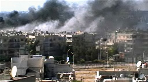 This video image taken from amateur video and broadcast by Bambuser/Homslive shows a series of devastating explosions rocking the central Syrian city of Homs, Syria, Monday, June 11, 2012. (Photo/Bambuser/Homslive via AP video)