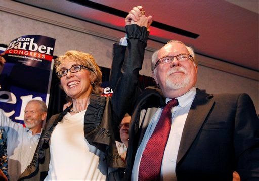 In an election to fill former Rep. Gabrielle Giffords, left, D-Ariz., congressional seat, Democratic candidate Ron Barber, right, celebrates a victory with Giffords at a post election event Tuesday in Tucson, Ariz. (AP Photo/Ross D. Franklin)