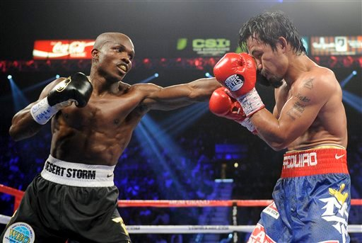 Timothy Bradley, from Palm Springs, Calif., left, lands a punch against Manny Pacquiao, from the Philippines, in their WBO world welterweight title fight Saturday, June 9, 2012, in Las Vegas. Bradley won the fight by split decision.