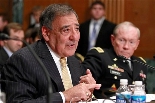 Defense Secretary Leon Panetta, left, accompanied by Joint Chefs Chairman Gen. Martin Dempsey testifies on Capitol Hill in Washington, Wednesday, June 13, 2012. (AP Photo/Jacquelyn Martin)