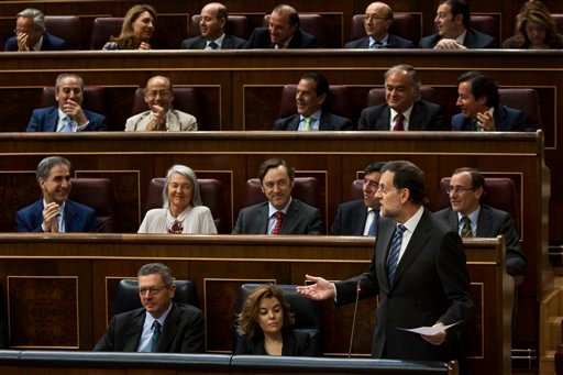 Spain's Prime Minister Mariano Rajoy speaks during a control session at the Spanish Parliament, in Madrid, Wednesday, June 13, 2012. (AP Photo/Daniel Ochoa de Olza)
