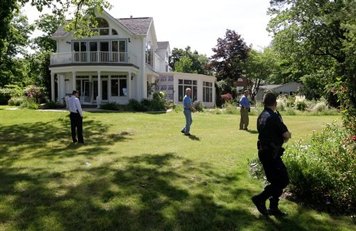 Law enforcement officers search the at home of Dr. Timothy Jorden in Hamburg, N.Y., Thursday, June 14, 2012. AP Photo/David Duprey)