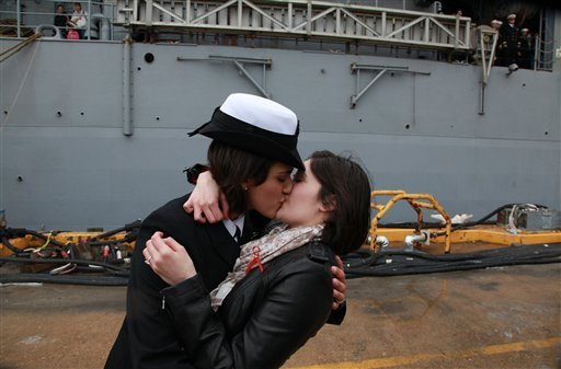 Petty Officer 2nd Class Marissa Gaeta, left, kisses her girlfriend of two years, Petty Officer 3rd Class Citlalic Snell, at Joint Expeditionary Base Little Creek in Virginia Beach, Va. (AP Photo/Virginian-Pilot, Brian J. Clark, File)