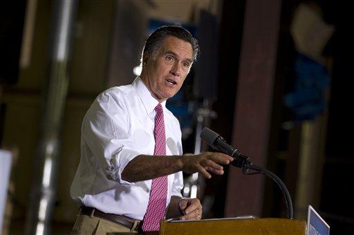 Republican presidential candidate, former Massachusetts Gov. Mitt Romney gestures during a campaign stop at Seilkop Industries in Cincinnati, Ohio, Thursday, June 14, 2012. (AP Photo/Evan Vucci)