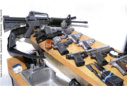This 2011 photo provided by the U.S. Attorney's office shows guns displayed in the Santa Monica, Calif., apartment where Whitey Bulger and Catherine Greig hid before their arrest in June 2011. (AP Photo/U.S. Attorney's Office)