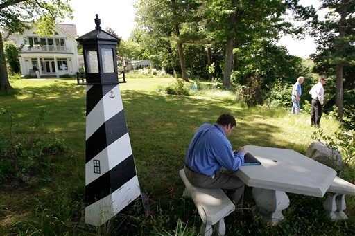 A Law enforcement officer takes notes at the home of Dr. Timothy Jorden in Hamburg, N.Y., Thursday, June 14, 2012. (AP Photo/David Duprey)